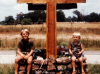 Tom Henry's sons sitting on church planter/sign he designed and built